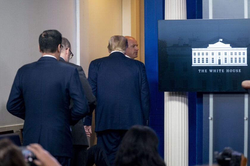 President Trump is asked to leave a White House briefing room by a member of the U.S. Secret Service