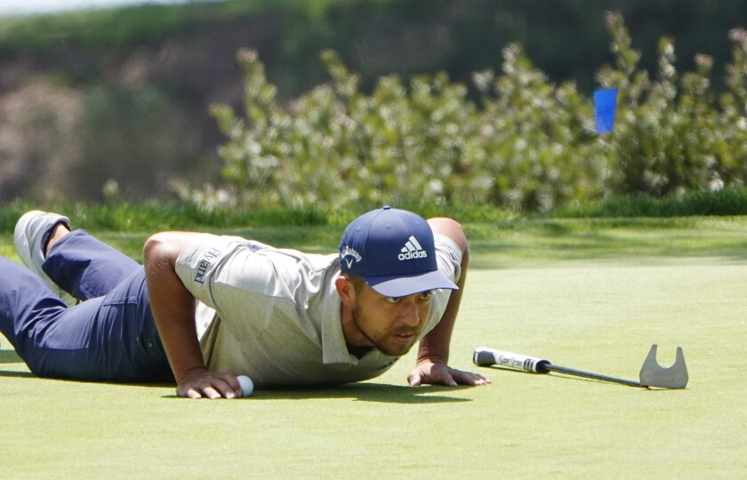 Xander Schauffele lines up a putt on the seventh hole of the Torrey Pines golf course during a U.S. Open practice round.