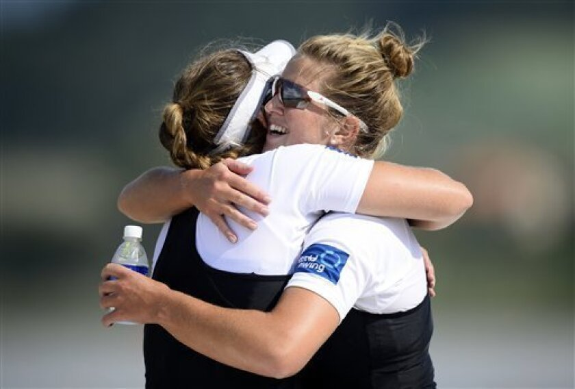 New Zealand's bronze medalists Kayla Pratt, right, and Rebecca Scown celebrate after the women's pair final event of the World Rowing Championships in Chungju, south of Seoul, South Korea, Saturday, Aug. 31, 2013. (AP Photo/Lee Jin-man)