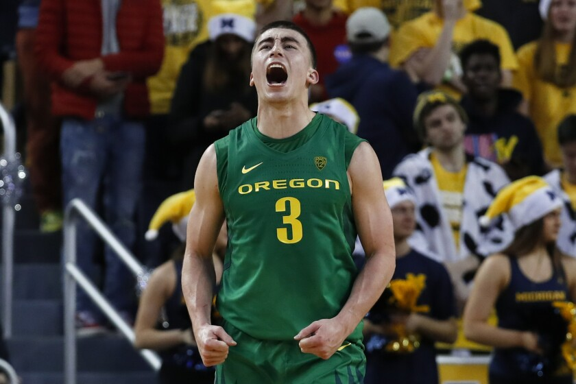 Oregon guard Payton Pritchard celebrates a basket against Michigan during the overtime of a game Dec. 14.
