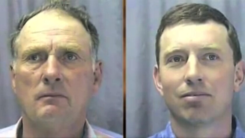 President Trump has pardoned Oregon ranchers Dwight Hammond, left, and his son Steven Hammond, both pictured in 2004. The Hammonds' run-ins with the law made them symbols in a struggle between landowners and federal authorities.