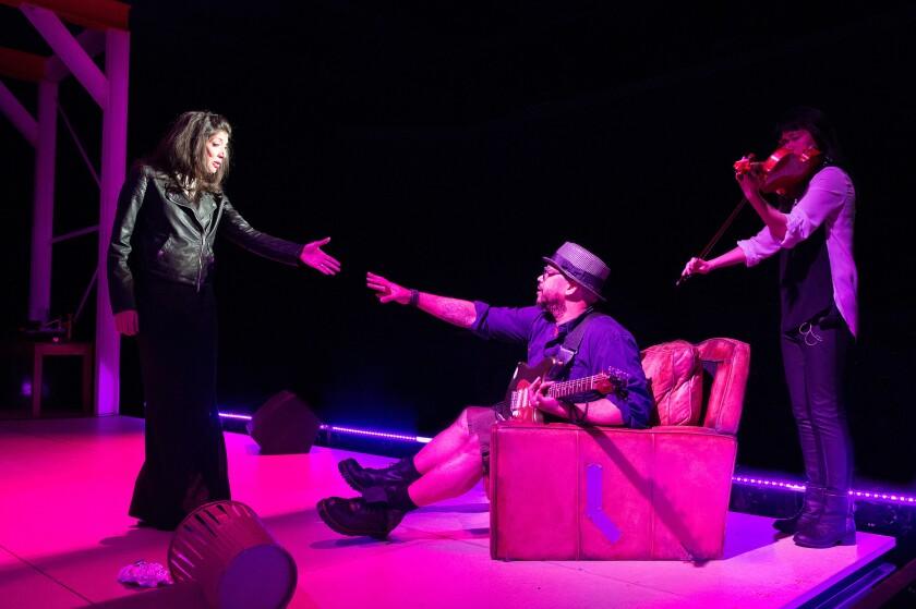 "Miriam A. Laube, Luqman Brown and Dana Lyn in a scene from ""Family Album."""