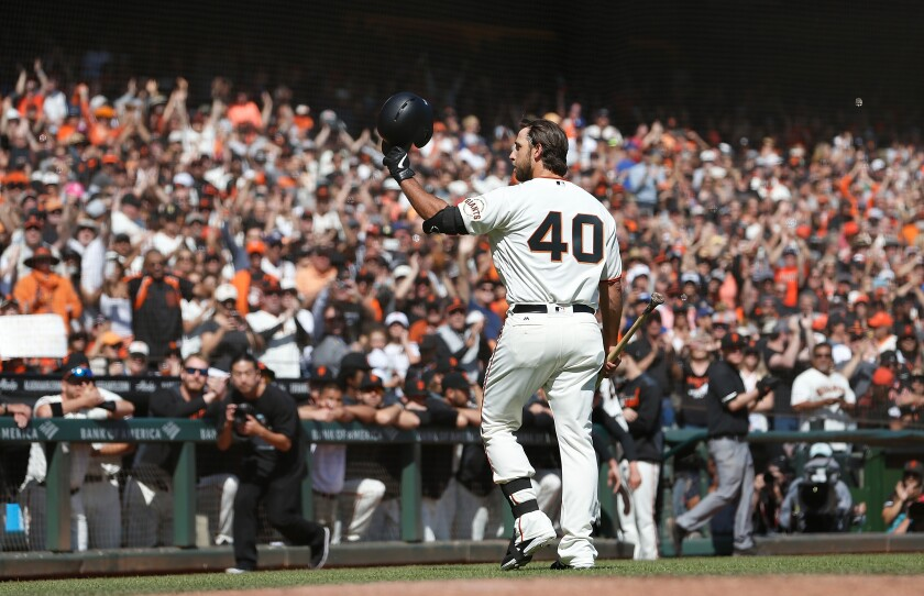 Giants pitcher Madison Bumgarner acknowledges the fans after pinch hitting against the Dodgers on Sunday.