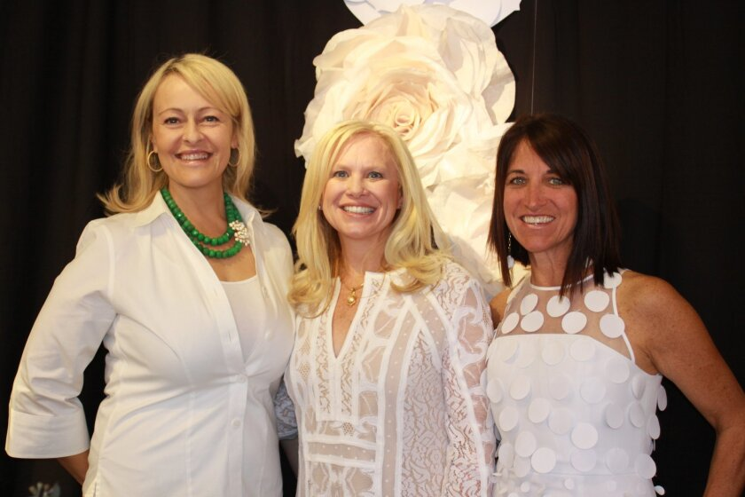 2015 Jewel Ball chair Cari Massaad (center) flanked by co-chairs Kathryn Gayner and Sherrie Black