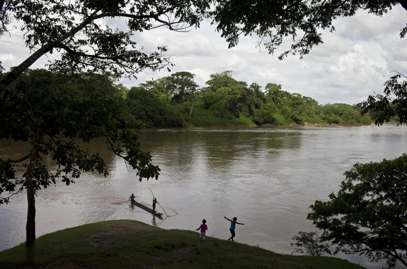 In this Sept. 19, 2015 photo, two Miskito girls displaced from communities by violence, on the banks of the Rio Coco in the Waspukta community, Nicaragua. In recent weeks Nicaragua's normally sleepy northern Caribbean coast has erupted in deadly clashes between Miskito Indians and mestizo, or mixed-race, settlers from the western part of the country. At least nine people were killed and 20 more wounded in September and hundreds of Miskito have fled their ancestral lands, in some cases escaping into neighboring Honduras. (AP Photo/Esteban Felix)