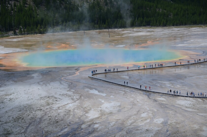 If you hike up the neighboring hillside, you get this view of Grand Prismatic Spring in Yellowstone National Park.