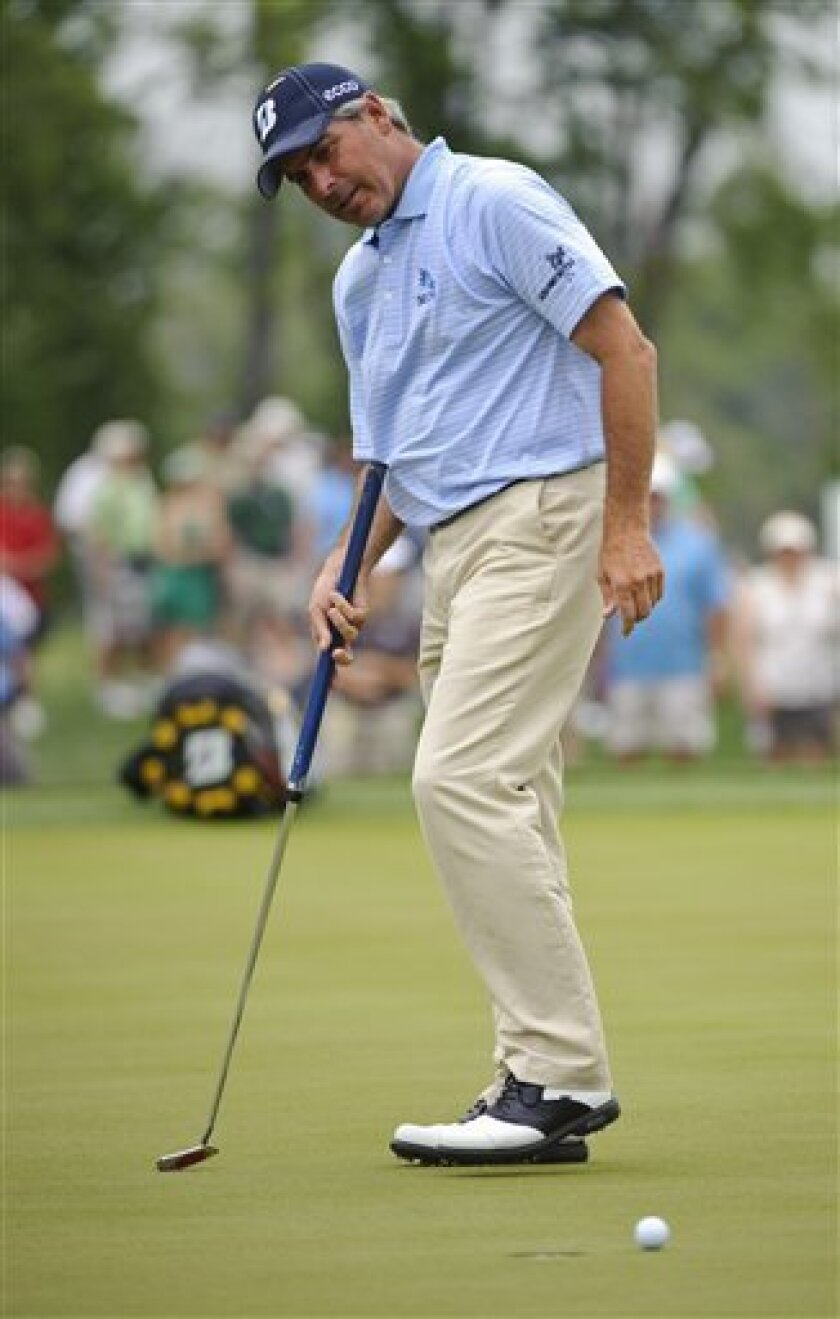 Fred Couples reacts to a missed birdie putt on the 15th hole during the final round of the Houston Open PGA Tour golf tournament on Sunday, April 3, 2011, in Humble, Texas. (AP Photo/Dave Einsel)