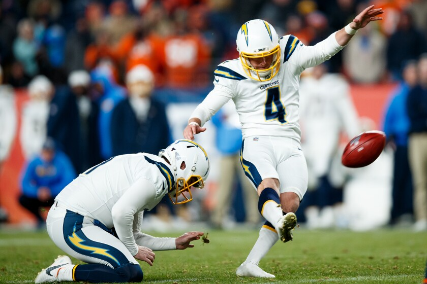 With Ty Long holding, the Chargers' Michael Badgley kicks a field goal last season against the Broncos in Denver.