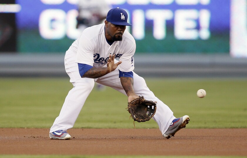 Dodgers second baseman Howie Kendrick fields a ground ball against during the first inning of a game against the Padres on Oct. 3.