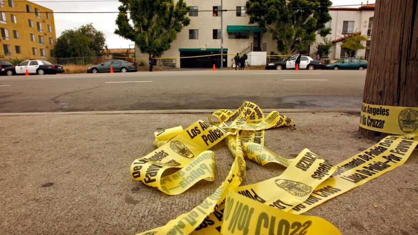 Crime tape where the body of a man in his 20's was discovered crumpled on the ground next to his bicycle in the 6800 block of Laurel Canyon Blvd in North Hollywood on June 6, 2011.