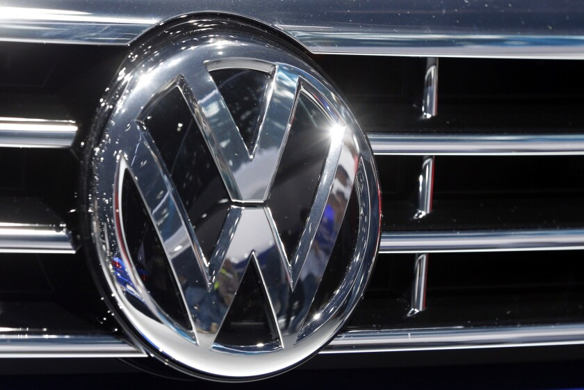 The Volkswagen logo is displayed on a vehicle at the Car Show in Frankfurt, Germany, on Sept. 22, 2015.