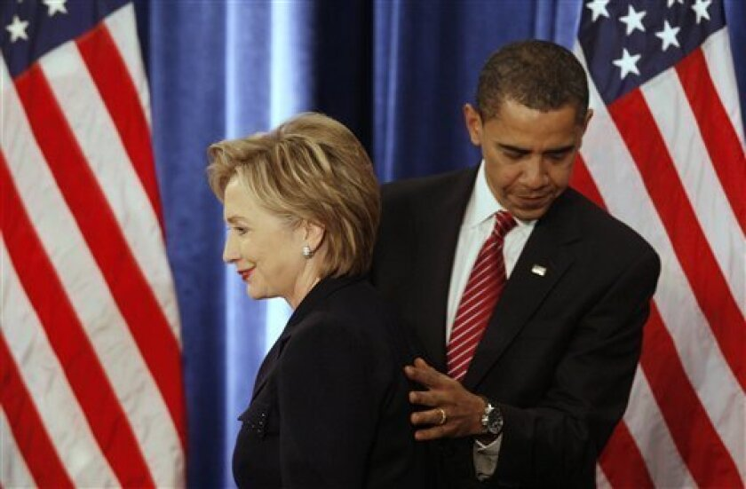 President-elect Barack Obama introduces Secretary of State-designate Sen. Hillary Rodham Clinton, D-N.Y., as a news conference in Chicago, Monday, Dec. 1, 2008. (AP Photo/Charles Dharapak)