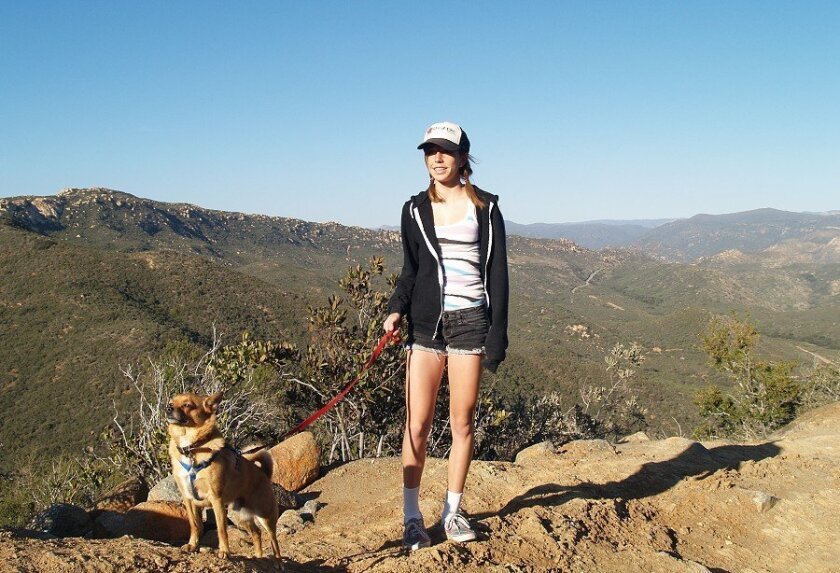 Michelle Read and her dog atop Lawson Peak in the Cleveland National Forest. (Wendy Fry)