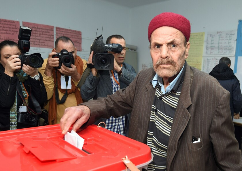 A man casts his vote at a polling station Sunday in Tunis, Tunisia.