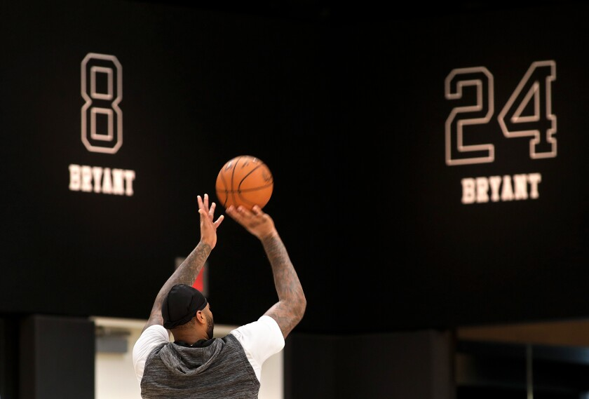 DeMarcus Cousins puts up a shot with Kobe Bryant's Nos. 8 and 24 in the background on Jan. 29 at the Lakers' practice facility in El Segundo.
