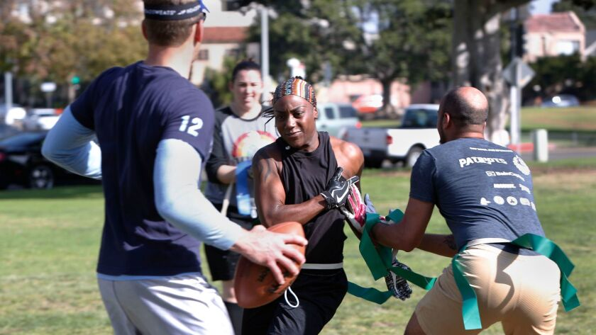 Philicia Harris, 30, who plays flag football to stay fit, went through a two-hour work out with teammates in Balboa Park. Their team is a co-ed mix that will play their first competitive game against other co-ed teams beginning in March.