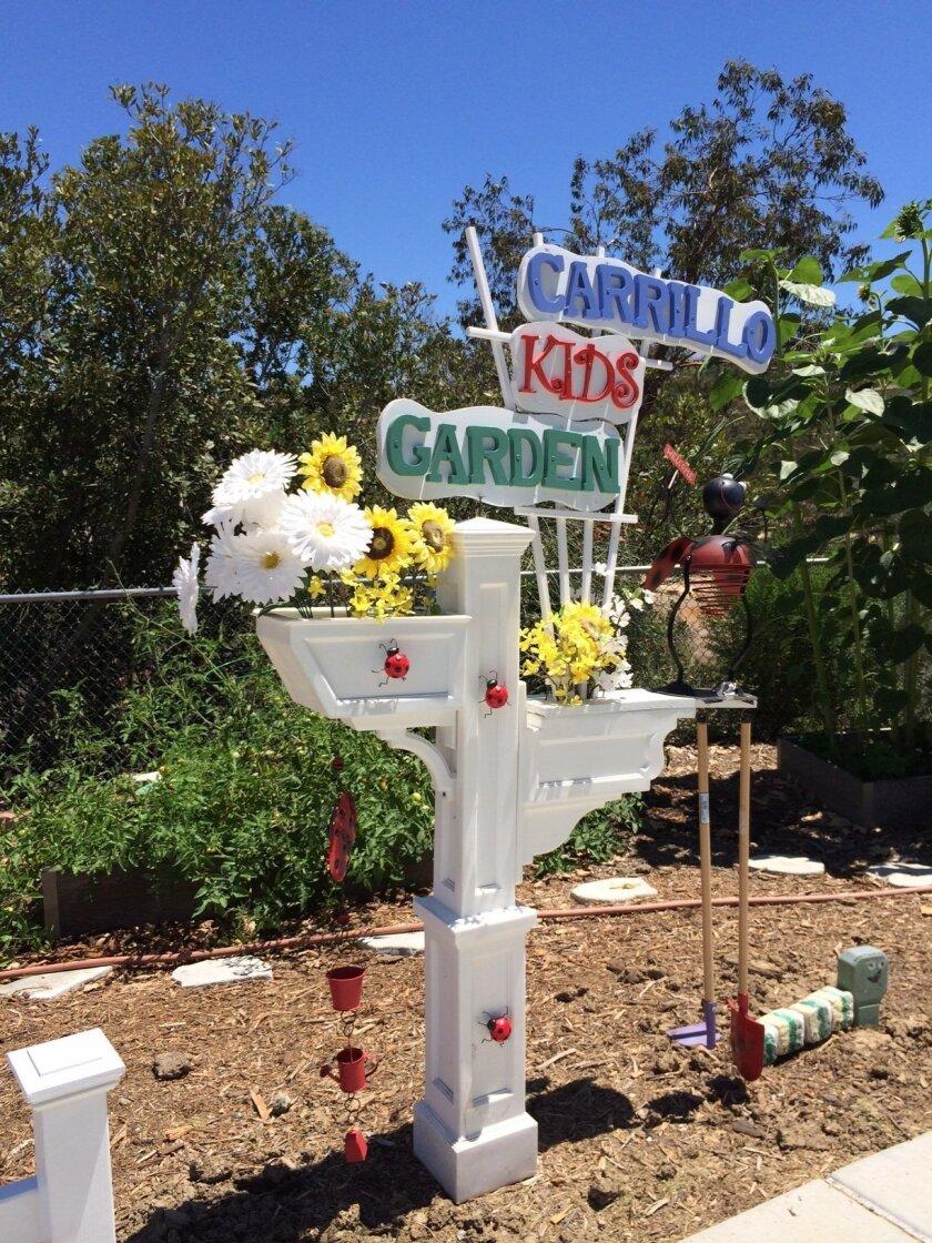 A sign made by a volunteer adorns the Carrillo garden.