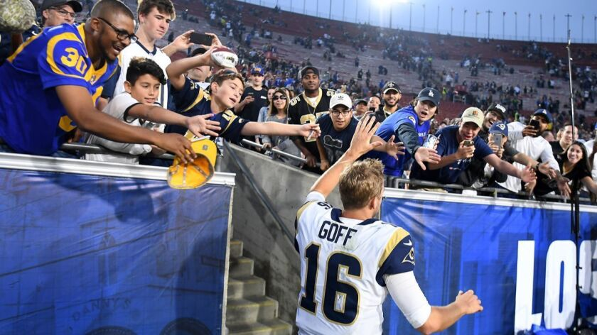 LOS ANGELES, CALIFORNIA SEPTEMBER 21, 2017-Rams quarterback Jaref Goff runs off the field during a r