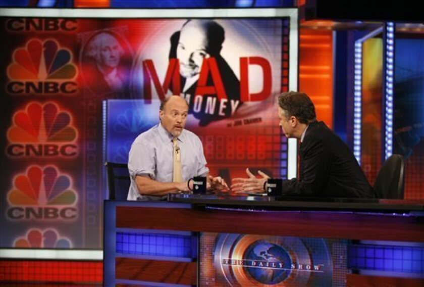 """Jim Cramer, left, host of CNBC's """"Mad Money"""" show talks with Jon Stewart during an appearance on Comedy Central's """"The Daily Show with Jon Stewart"""" Thursday, March 12, 2009 in New York. (AP Photo/Jason DeCrow)"""