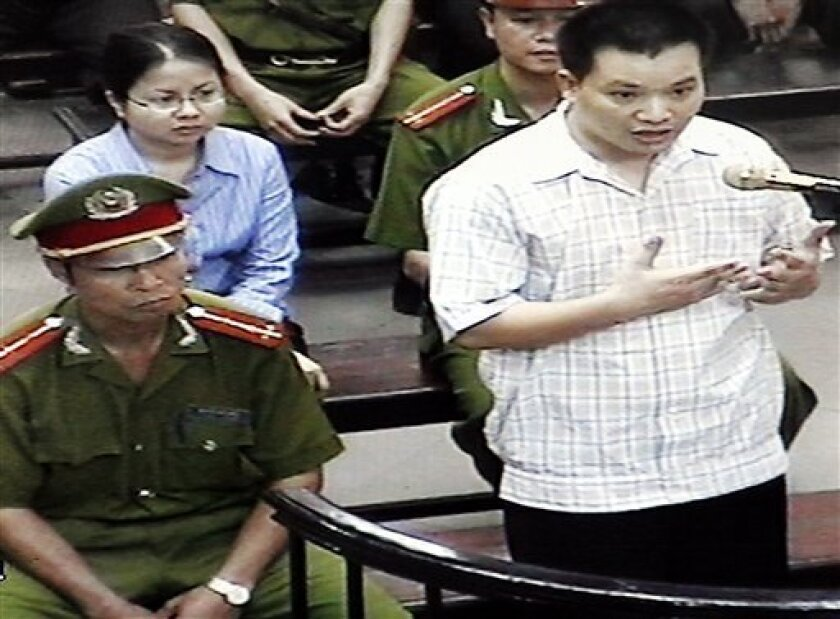 FILE - in this Friday, May 11, 2013 file photo, originally taken from TV footage, Nguyen Van Dai, right, testifies at a court as his fellow human rights activist Le Thi Cong Nhan, left in second row, listens during their trial in Hanoi, Vietnam. Deputy Secretary of State Dan Baer wanted to meet Nguyen Van Dai and Pham Hong Son, two dissidents well known to Western governments and rights organizations when he was in Vietnam. They have each served four-year prison terms in the past. They are under