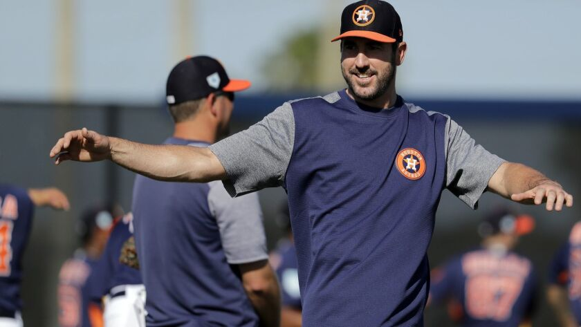 Houston Astros pitcher Justin Verlander stretches during spring training baseball practice Friday, F