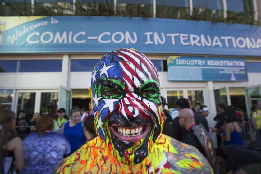 The Annual Comic-Con International Convention opens up with the preview night downtown at the Convention Center.   Large crowds thronged the entrance to get credentials and check out the scene. Kris Keyes who goes by Nomad Divebomber stands outside of the Convention Center as large crowds make thei