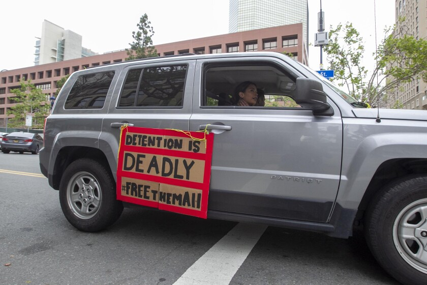 About 50 cars participated in an anti-immigration detention rally in downtown San Diego on Tuesday, March 31, 2020. The protestors are trying to get non-criminal detainees released from the Otay Mesa Detention Center out of fear that an COVID-19 outbreak could kill many people.