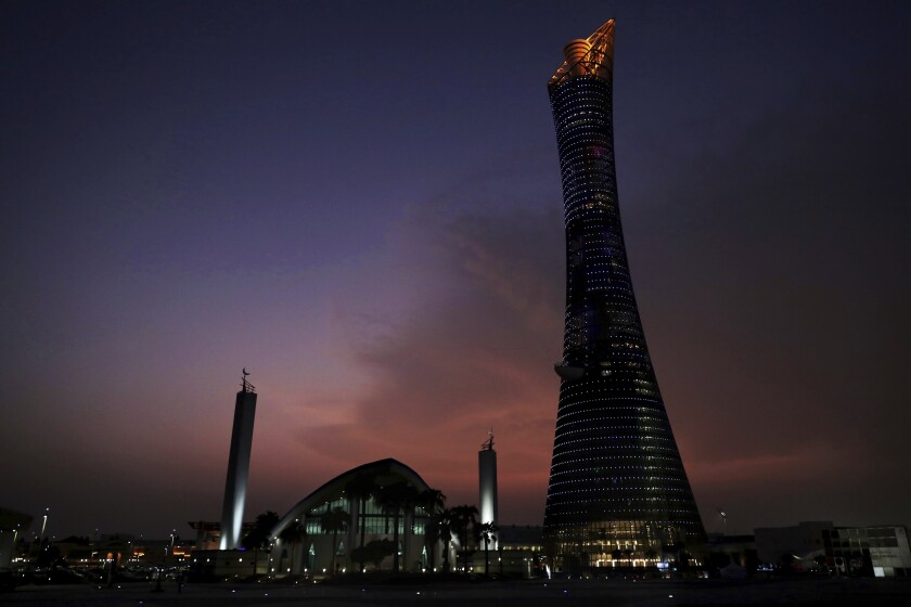 The sun sets behind the Khalifa International Stadium prior to the start of the World Athletics Championships in Doha, Qatar, Thursday, Sept. 26, 2019. (AP Photo/Nariman El-Mofty)