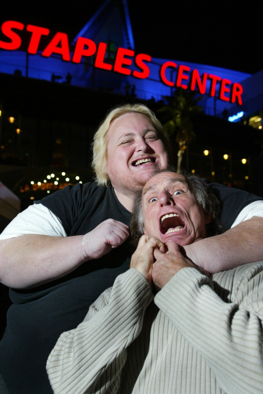 Sports talk radio personalities Joe McDonnell, left, and Doug Krikorian have a little fun outside Staples Center in 2004.