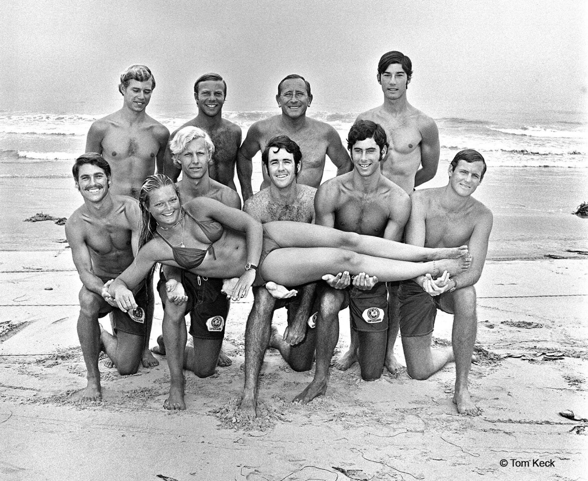 Del Mar city lifeguards pose for their yearly photo in 1971. Kneeling left to right are Tom Cozens, Robert Maurer, Robert Smith, Vernon Rye III and Brad Smith. Standing left to right are Dan Jago, Petey Hoff, Gardner Stevens and Dave Grossman. Joyce Hoffman, the female lifeguard, was a U.S. and world surfing champion.