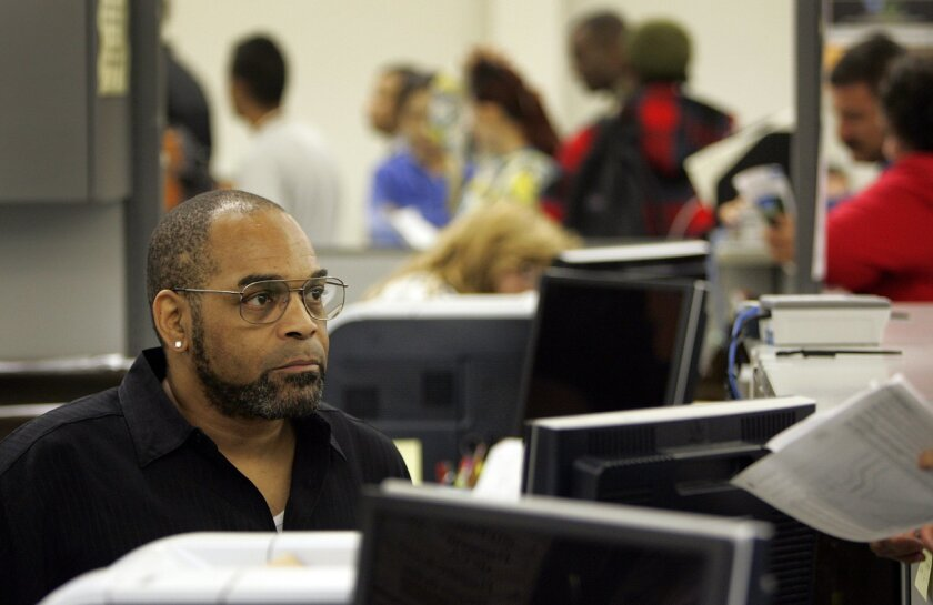 A staff member works at the DMV branch in Hillcrest in this 2010 U-T file photo.