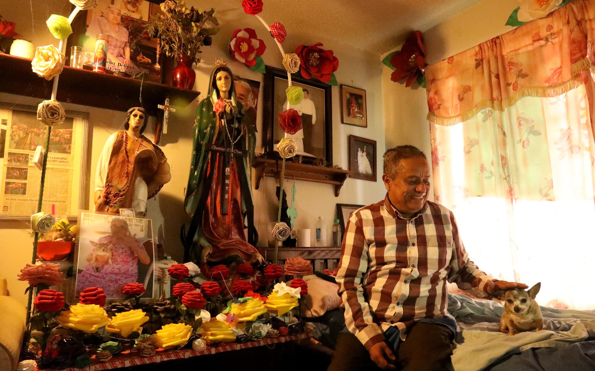 Hilario Herrera is shown inside his apartment in the Oak View neighborhood in Huntington Beach.