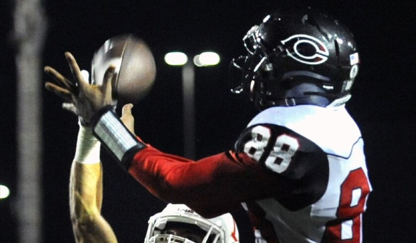 Corona Centennial receiver Javon McKinley can't come up with the catch but Orange Lutheran's Lance Dravis is called for pass interference in the third quarter.