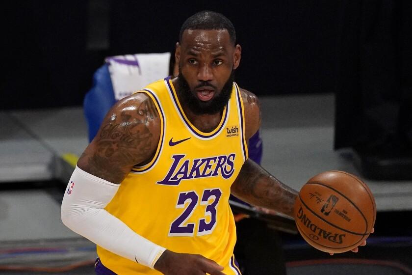 Los Angeles Lakers forward LeBron James dribbles.