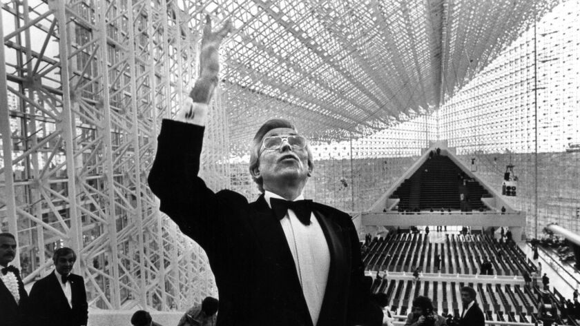 Dr. Robert Schuller conducts a presconcert tour of the new Crystal Cathedral on May 14, 1980.