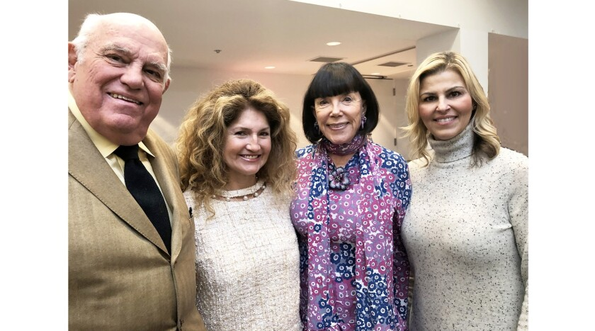 Dr. John Dorr, from left, Analily Park, Gayle Roski and Sandy Kobessi attend the art opening at USC