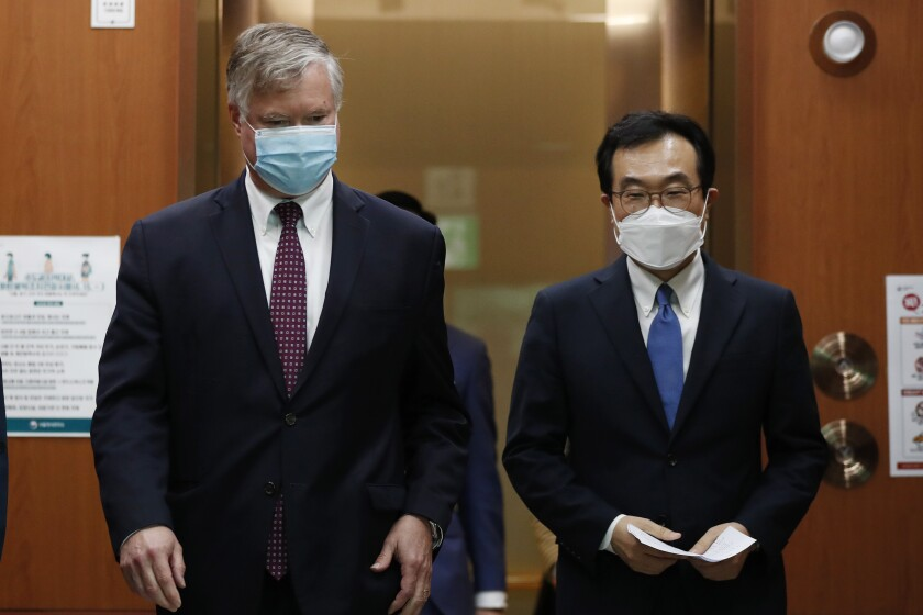 U.S. Deputy Secretary of State Stephen Biegun, left, walks with his South Korean counterpart Lee Do-hoon after their meeting at the Foreign Ministry in Seoul Wednesday, July 8, 2020. Biegun is in Seoul to hold talks with South Korean officials about allied cooperation on issues including North Korea. (Kim Hong-ji/Pool Photo via AP)