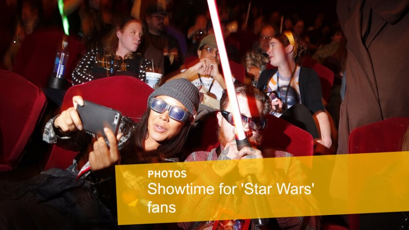 """Scenes from the opening night of """"Star Wars: The Force Awakens"""": Fans wait for the start of the movie at the TCL Chinese Theatre in Hollywood."""