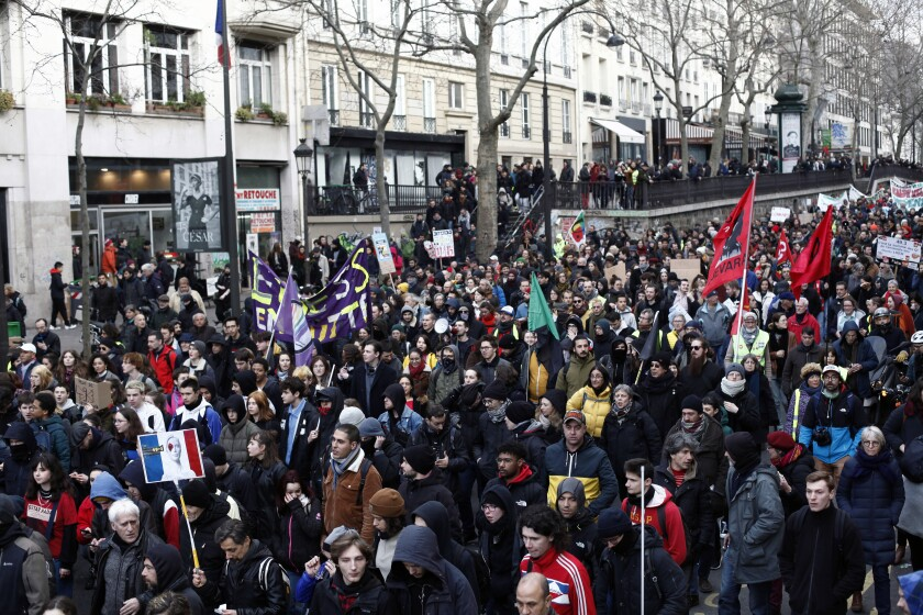 Demonstrators march to protest against pension reform plans, in Paris, Tuesday, March 3, 2020. French President Emmanuel Macron's government is trying to pass contested pension changes at the lower house of parliament without a vote amid protests from opposition lawmaker and labor unions. (AP Photo/Thibault Camus)
