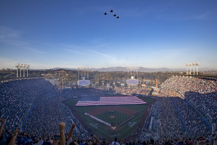 The Fresno Air National Guard 144th Fighter Wing fly over Dodger Stadium as country music star Brad Paisley sings the Star Spangled Banner before Game 3 of the World Series on Friday.