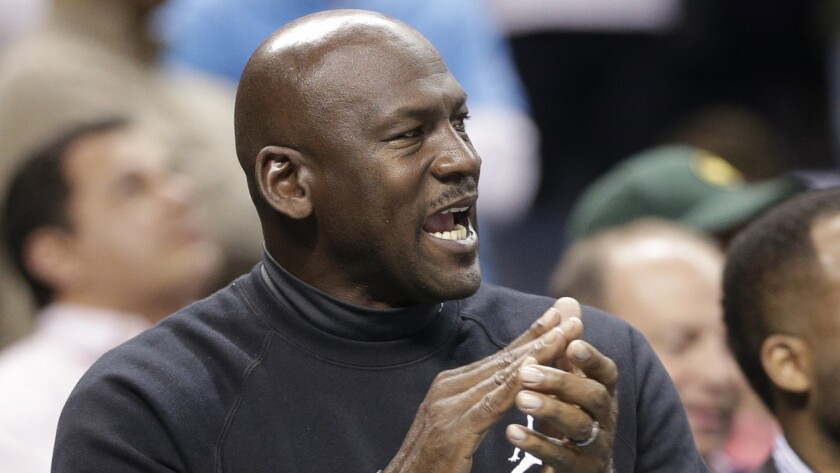 Michael Jordan, Charlotte Hornets owner, applauds during a game against the Washington Wizards on Feb. 5.