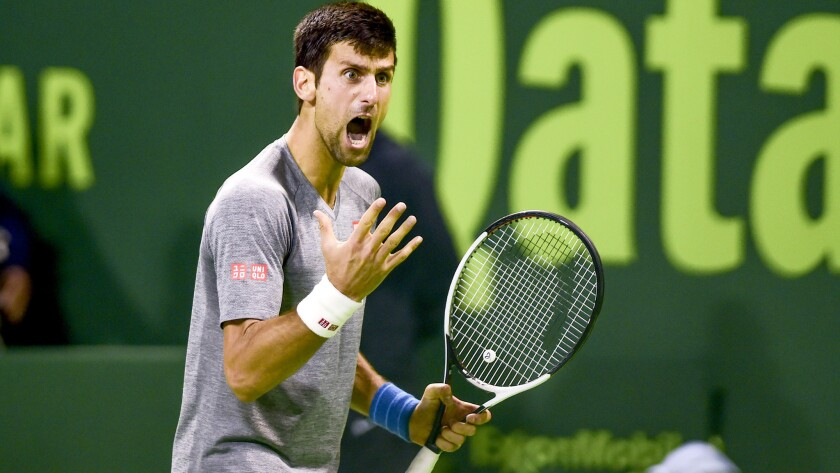 Novak Djokovic reacts after winning a point against Andy Murray during the championship match of the Qatar Open on Saturday.