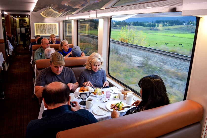 Passengers dining aboard the Rocky Mountaineer train.