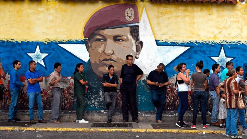 Venezuelans line up outside a polling station during regional elections in Caracas, Venezuela, on Oct. 15, 2017.