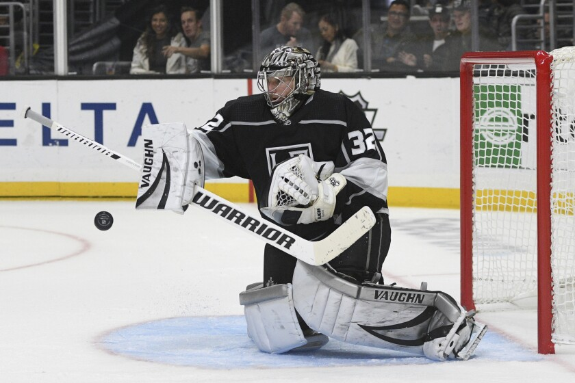 Kings goalie Jonathan Quick blocks a shot by the Detroit Red Wings during the third period on Thursday at Staples Center.