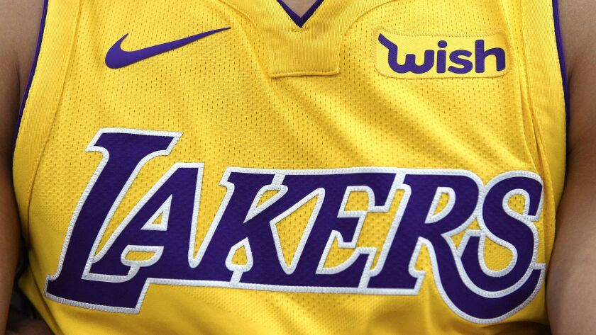 "The new Los Angeles Lakers Nike jersey with the sponsor logo ""Wish"" on the left chest is seen during media day in El Segundo, Calif. on Sept. 2."