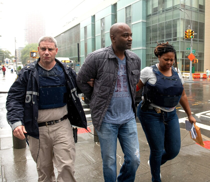 NYPD Police Officer Edward St. Hill, middle, is escorted into Brooklyn Supreme Court Tuesday.