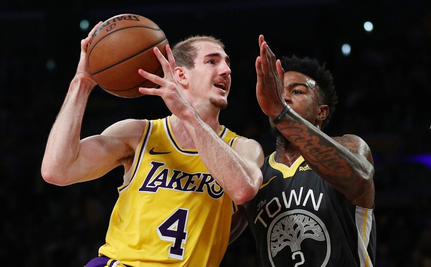Lakers guard Alex Caruso drives to the basket against Golden State's Jordan Bell.