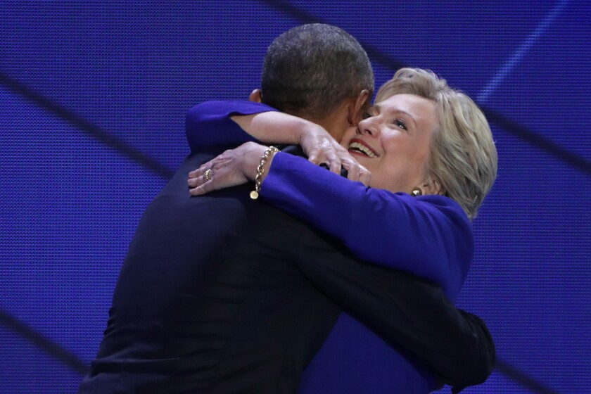 Hillary Clinton and President Obama embrace after his Wednesday night speech at the Democratic National Convention.
