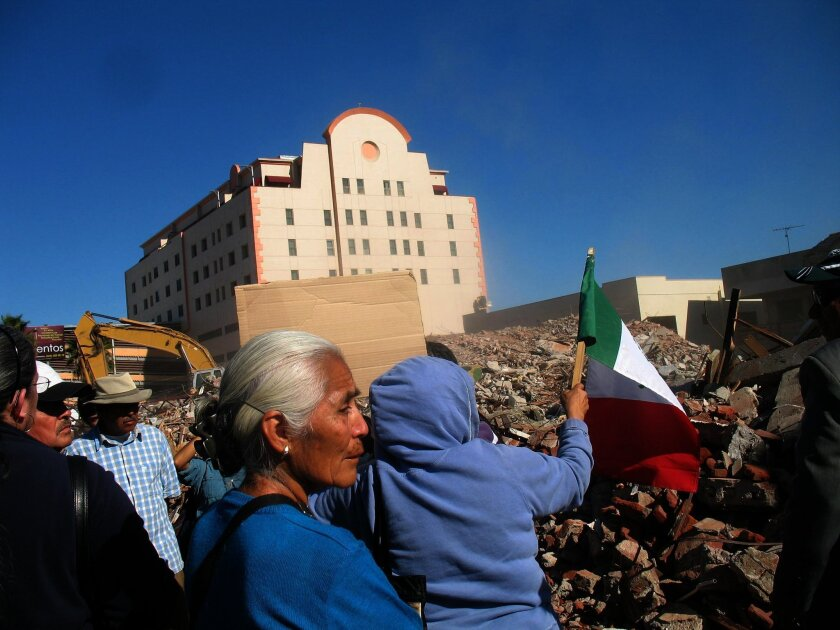 Protesters standing by the rubble of the former La Ocho police station in Tijuana on January 9, 2012.